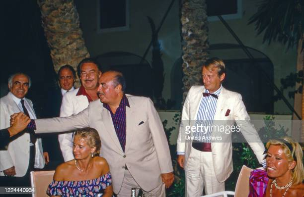 Adnan Khashoggi at an evening event with Alfonso Prince of Hohenlohe Langenburg in Marbella, Spain, 1985.
