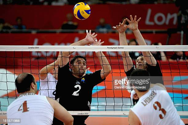 Adnan Manko of Bosnia and Herzegovina and teammate Dzevad Hamzic of Bosnia and Herzegovina block a ball during the Men's Sitting Volleyball Gold...