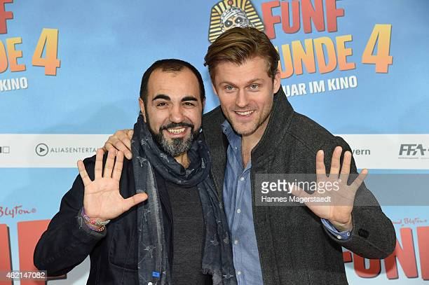 Adnan Maral and Jens Atzorn aattend the premiere of the film 'Fuenf Freunde 4' at Cinemaxx on January 25 2015 in Munich Germany