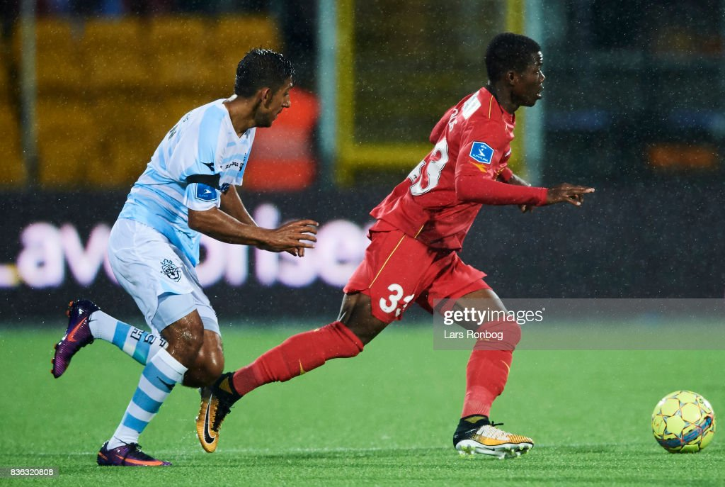 Adnan Mohammad of FC Helsingor chasing Collins Tanor of FC Nordsjalland during the Danish Alka Superliga match between FC Nordsjalland and FC Helsingor at Right to Dream Park on August 21, 2017 in Farum, Denmark.