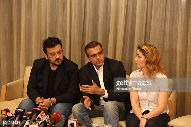 Adnan Sami with his wife Roya and Lawyer Vaibhav Krishna during a press conference at Oberoi Sky Garden City building Andheri