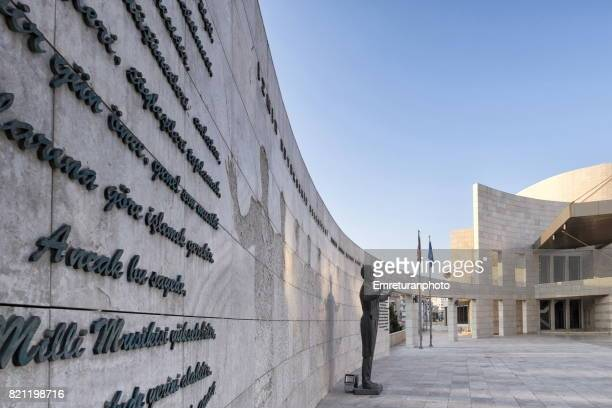adnan saygun concert hall surrounding wall with the composers' statue in izmir. - emreturanphoto stock pictures, royalty-free photos & images