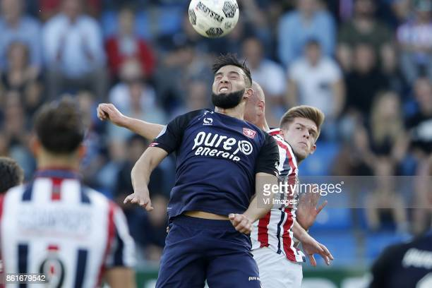Adnane Tighadouini of FC Twente Elmo Lieftink of Willem II Marko Kvasina of FC Twente during the Dutch Eredivisie match between Willem II Tilburg and...