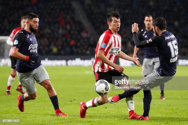 Adnane Tighadouini of FC Twente Hirving Lozano of PSV Cristian Cuevas of FC Twente during the Dutch Eredivisie match between PSV v Fc Twente at the...