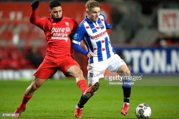 Adnane Tighadouini of FC Twente Martin Odegaard of Heerenveen during the Dutch Eredivisie match between Fc Twente v SC Heerenveen at the De Grolsch...