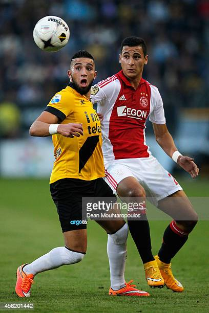 Adnane Tighadouini of NAC and Anwar El Ghazi of Ajax battle for the ball during the Dutch Eredivisie match between NAC Breda and Ajax Amsterdam at...