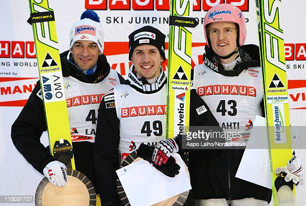 Adnreas Kofler of Austria Simon Ammann of Switzerland and Severin Freund of Germany pose on the podium after the large hill HS130 during the FIS Ski...