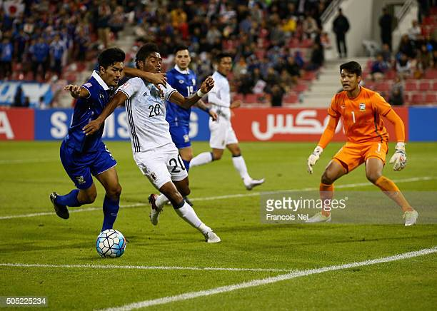 Ado Onaiwu of Japan battles for the ball with with Adison Promrak of Thailand during the AFC U23 Championship Group B match between Thailand and...