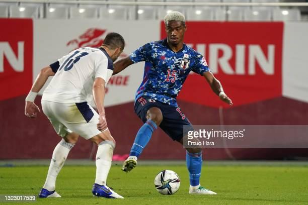 Ado Onaiwu of Japan takes on Stefan Mitrovic of Serbia during the international friendly match between Japan and Serbia at Noevir Stadium Kobe on...
