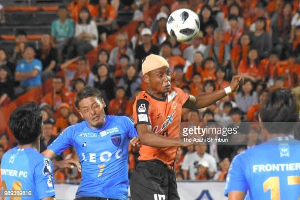 Ado Onaiwu of Renofa Yamaguchi and Naoki Nomura of Yokohama FC compete for the ball during the JLeague J2 match between Renofa Yamaguchi and Yokohama...