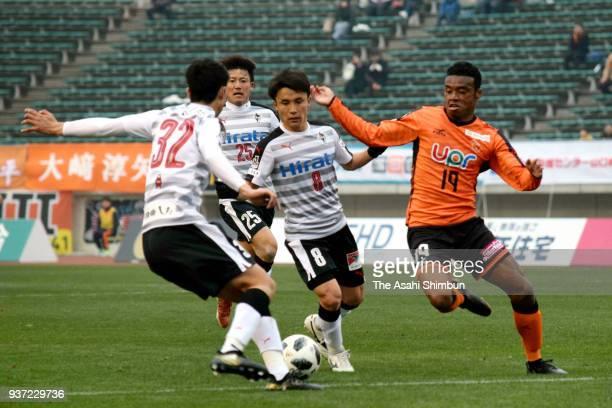 Ado Onaiwu of Renofa Yamaguchi and Shusuke Yonehara of Roasso Kumamoto compete for the ball during the JLeague J2 match between Renofa Yamaguchi and...
