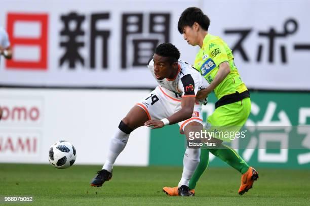 Ado Onaiwu of Renofa Yamaguchi and Yusuke Chajima of JEF United Chiba compete for the ball during the JLeague J2 match between JEF United Chiba and...