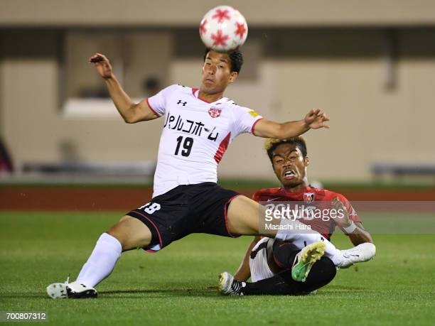 Ado Onaiwu of Urawa Red Diamonds and Gaku Sugamoto of Gurlla Morioka compete for the ball during the 97th Emperor's Cup second round match between...