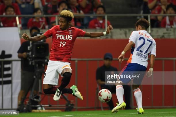 Ado Onaiwu of Urawa Red Diamonds and Yuto Horigome of Albirex Niigata compete for the ball during the JLeague J1 match between Urawa Red Diamonds and...
