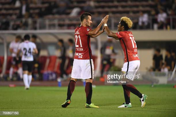 Ado Onaiwu of Urawa Red Diamonds celebrates the third goal during the 97th Emperor's Cup second round match between Urawa Red Diamonds and Gurlla...
