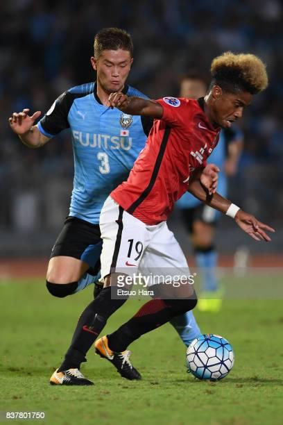 Ado Onaiwu of Urawa Red Diamonds controls the ball under pressure of Tatsuki Nara of Kawasaki Frontale during the AFC Champions League quarter final...