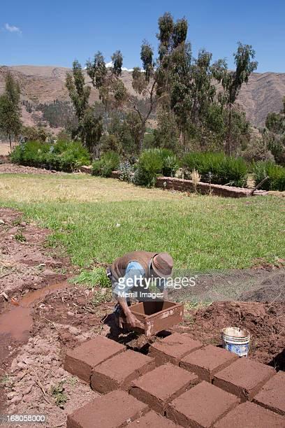 Adobe mud bricks dryig in the sun in Peru