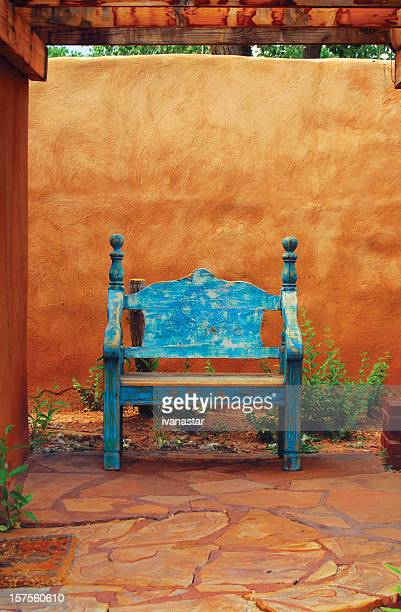 Adobe Patio with Wooden Bench
