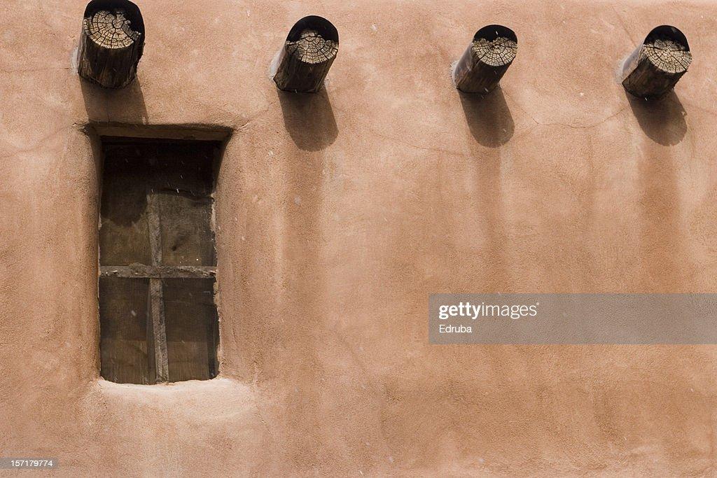 Adobe wall, window, and beams : Stock Photo