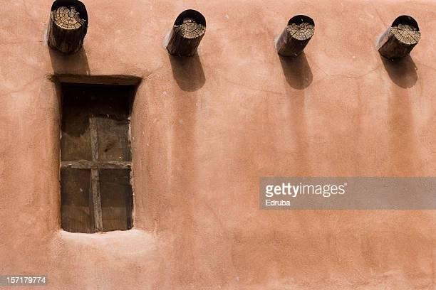 Adobe wall, window, and beams