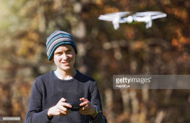 adolescent boy flying a toy drone quadcopter - remote control helicopter stock photos and pictures
