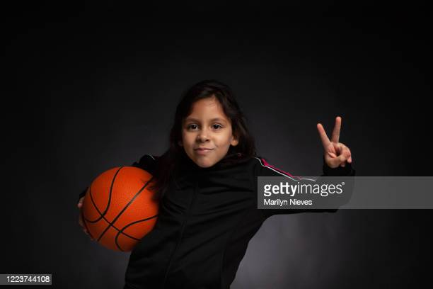 """adolescent girl goofing off with a basketball - """"marilyn nieves"""" stock pictures, royalty-free photos & images"""