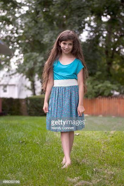 Adolescent girl with long hair