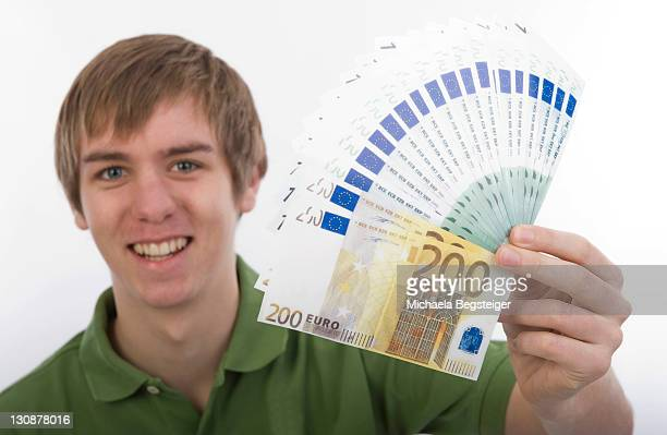 Adolescent, 18, holding banknotes