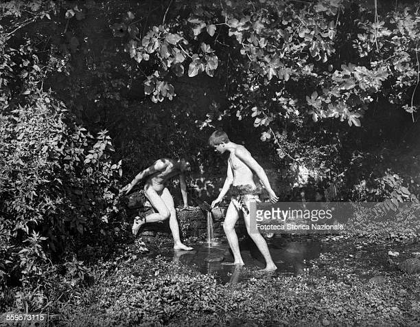 Adolescent males as sylvan fauns caught while drinking at a spring in the woods Photography attributed to Wilhelm von Plüschow Italy approx 1900