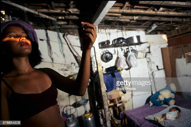 Adolescent mother put on makeup for a date while her baby sleeps teenage pregnancy associated with social issues lower educational levels and higher...