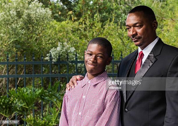 Adolescent Son And Father Portrait
