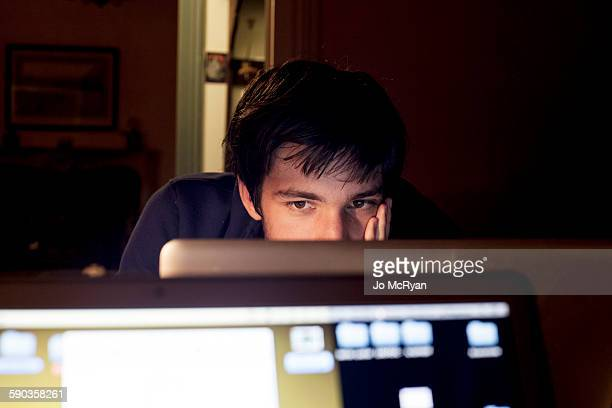 Adolescent staring at computer screen