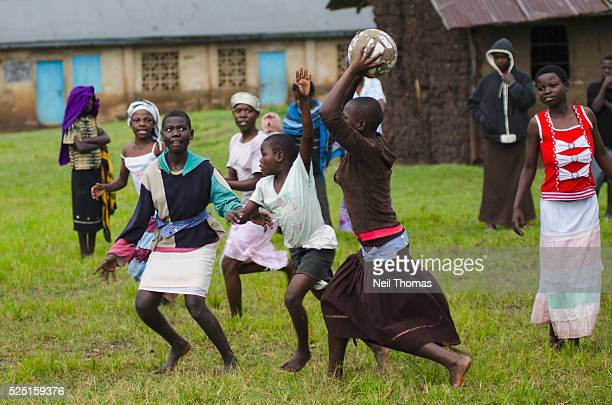 Adolescent Ugandan girls play netball in the village of Bumweru Uganda Adolescents constitute 28% of the population Young girls are particularly...