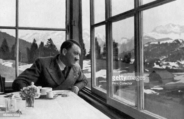 Adolf Hitler admiring the view out a window near Garmisch Bavaria Germany 1936 A print from Adolf Hitler Bilder aus dem Leben des Führers Hamburg...