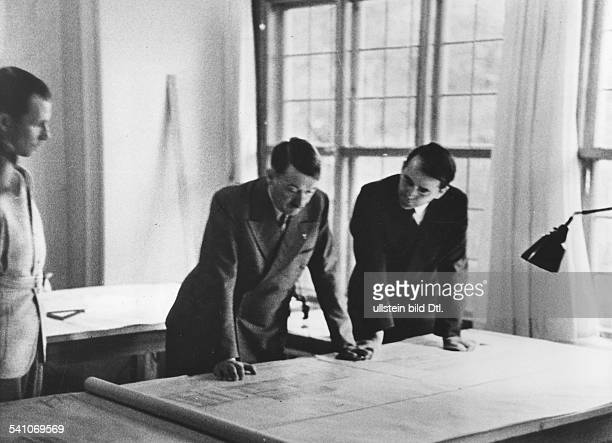 Adolf Hitler Adolf Hitler *20041889 Politiker Nazi Party Germany Hitler looking into an architectural drawing for a new opera building at Linz at the...