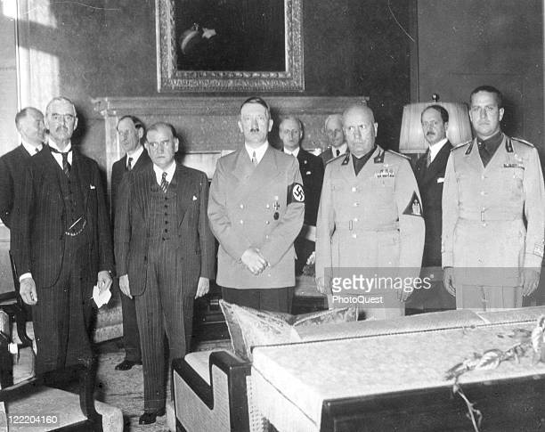 Adolf Hitler and Benito Mussolini accompanied by Mussolini's soninlaw and Italian Foreign Minister conferred with British Primie Minister Neville...