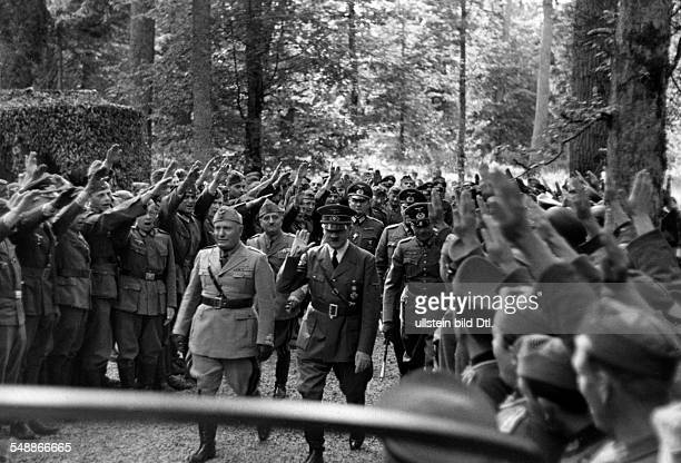 Adolf Hitler and Benito Mussolini in the area of the infantry headquarters in the Mauerwald near Angerburg in East Prussia following them left Ugo...