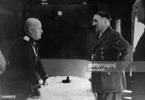 Adolf Hitler and Benito Mussolini under discussion in the chartered train of the Italian politician, right: Reich Minister Joachim von Ribbentrop -...