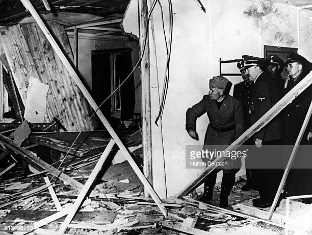 Adolf Hitler and Benito Mussolini visit Hitler's damaged headquarters in East Prussia after an attempt on Hitler's life there in July 1944. Colonel...