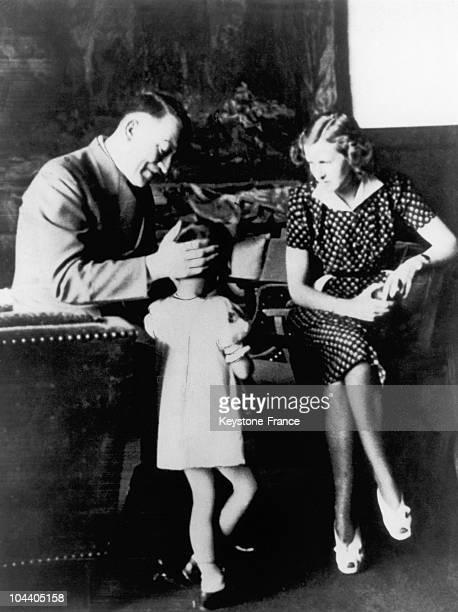Adolf HITLER and Eva BRAUN with a little girl around 1940 Since August 1932 Eva BRAUN had been HITLER's mistress