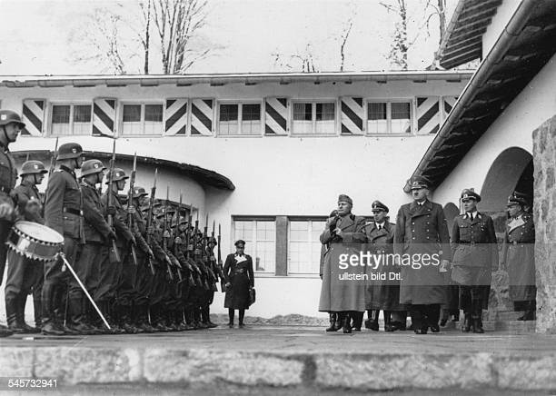 Adolf Hitler and Italian leader Benito Mussolini are taking the salute of a guard of honour of the Leibstandarte SS Adolf Hitler in front of the...