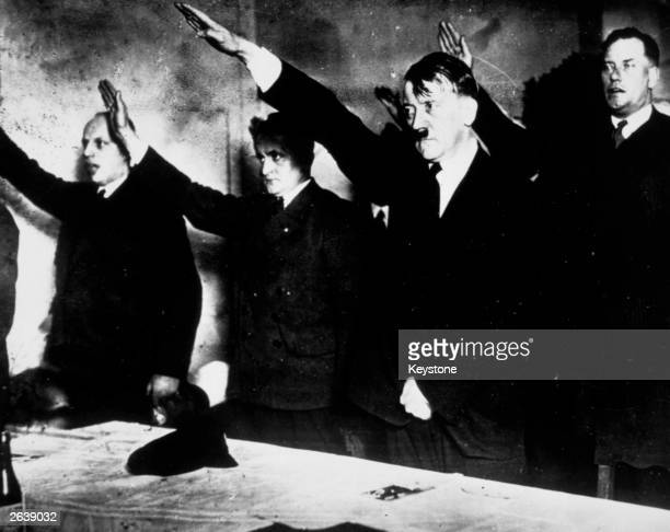 Adolf Hitler and members of the National Socialist Party giving the Nazi salute after winning elections at Lemgo, Lipps.