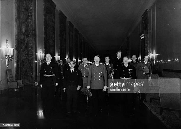 Adolf Hitler and the japanese foreign minister in the 'long hall' on their way to the balcony of the Reich chancelloryi in the group to the left Dr...