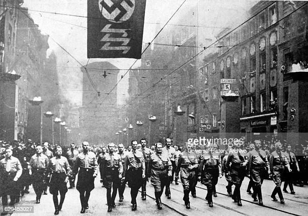 Adolf Hitler and the Nazis marching against the Treaty of Versailles