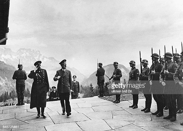 Adolf Hitler and Tsar Boris III of Bulgaria are taking the salute of a guard of honour of the Leibstandarte SS Adolf Hitler on the terrace of the...