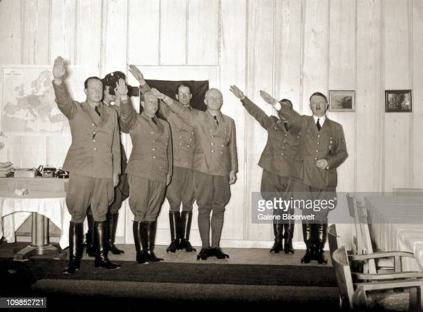 Adolf Hitler and visitors to the Berghof giving the Nazi salute Berchtesgaden Germany 1942 Among the guests are Foreign Minister Joachim von...