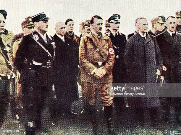 Adolf Hitler arrives in Munich 193334 Rudolf hess is shown to the right of Hitler