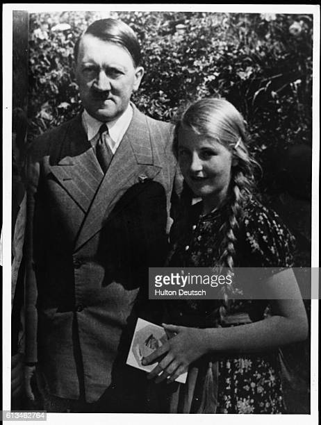 Adolf Hitler As He Likes To Pose With A Little Girl Who Got His Autographed Pi