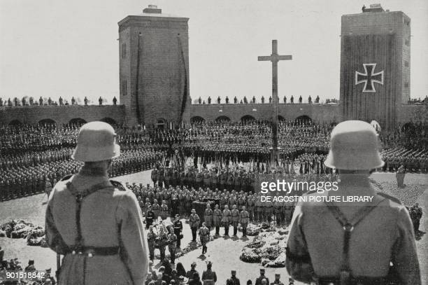 Adolf Hitler attends a military ceremony in front of Tannenberg Memorial eastern Prussia now Poland photo by BFA and AP from L'illustrazione Italiana...