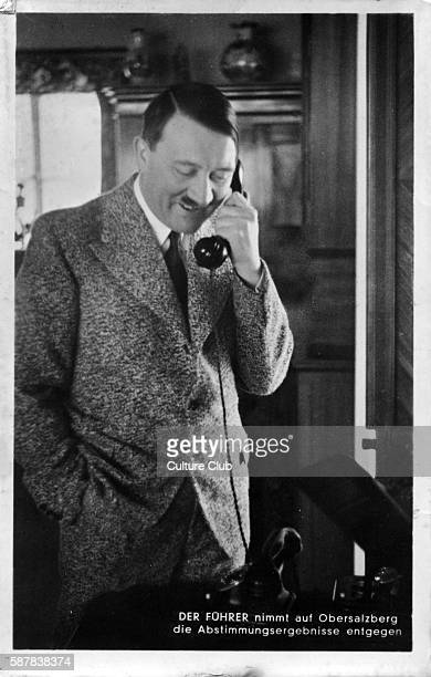 Adolf Hitler Austrianborn German politician and the leader of the Nazi Party speaking on the telephone Caption reads der fuhrer nimmt auf...